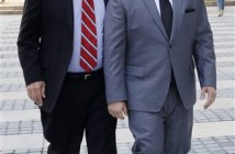 New York Senate Majority Leader Dean Skelos, left, and his son Adam arrive at FBI offices, Monday, May 4, 2015, in New York. The pair surrendered to face charges including extortion and soliciting bribes amid a federal investigation into the awarding of a $12 million contract to a company that hired his son. (AP Photo/Mark Lennihan)