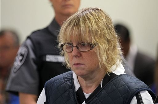 In this June 15, 2015, file photo, Joyce Mitchell appears before Judge Mark Rogers in Plattsburgh, N.Y., City Court for a hearing. The New York prison worker accused of smuggling hacksaw blades in frozen hamburger meat to two killers who later broke out and spent more than two weeks on the run will face charges in court and will be arraigned on Tuesday, July 28, 2015. (G.N. Miller/New York Post via AP, Pool, File)