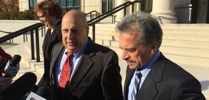 Ex-Sen. Thomas Libous, center, speaks Tuesday on the steps of the federal courthouse in White Plains. He was accompanied by his wife, Frances, and his attorney, Paul DerOhannesian.