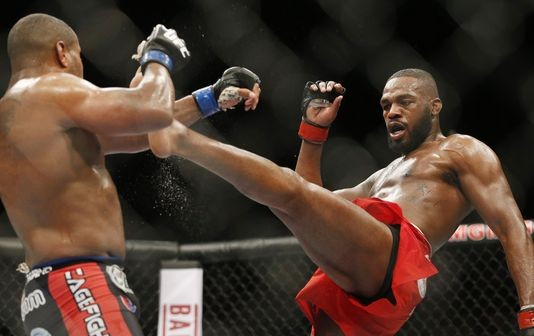 Jon Jones kicks Daniel Cormier during the light-heavyweight championship fight on Jan. 3, 2015. (Photo: Associated Press)